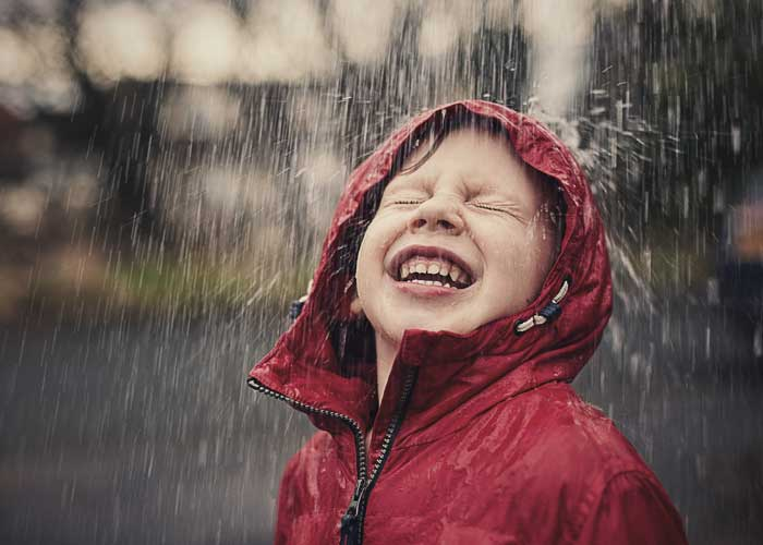 boy in red raincoat