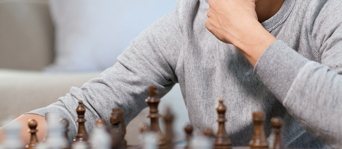 Man playing chess and thinking about his next move