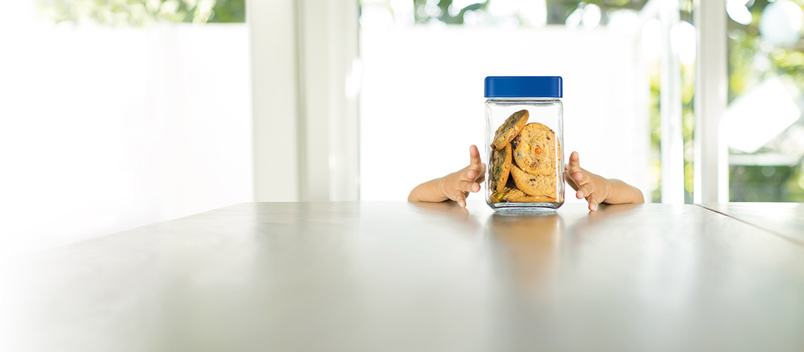 Child reaching for a cookie jar